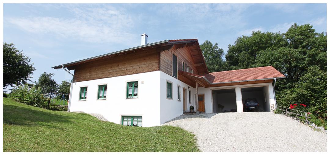 Moser Holzbau Blockhaus Einfahrt
